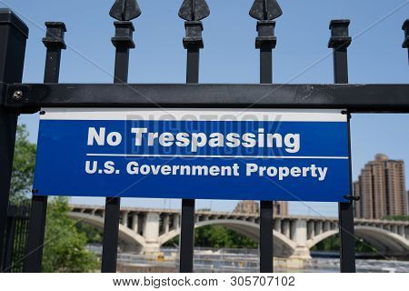 Sign For No Trespassing - Us Government Property Along The Mississippi Riverfront In Downtown Minnea