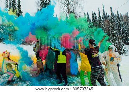 Sheregesh, Kemerovo Region, Russia - April 06, 2019: A Group Of A Young People Throwing Colorful Hol