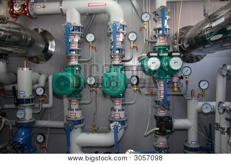 Pumps pipelines and devices in an interior of modern boiler-house poster