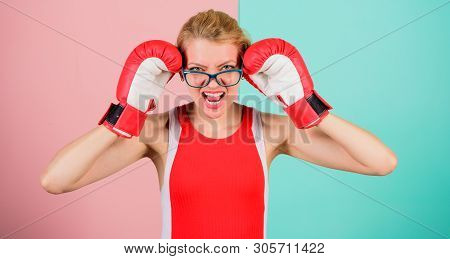Win with strength or intellect. Strong intellect victory pledge. Know how defend myself. Confident her power. Strong mentally and physically. Smart and strong. Woman boxing gloves adjust eyeglasses poster