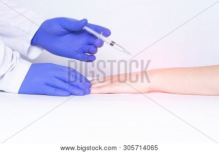 Doctor Injects Blockade Into Wrist Joint With Chondroprotector And Analgesic Drug, Close-up, Medical