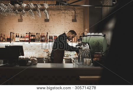 Barista At The Restaurant Bar Counter.portrait Of A Bartender With A Job In A Cozy Restaurant.owner