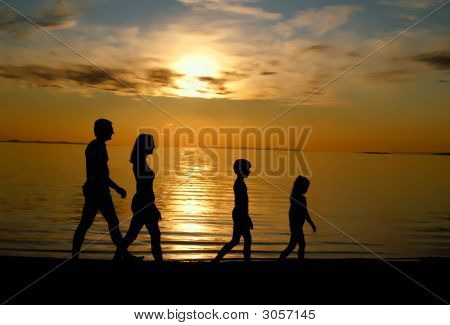 Family Strolling On Beach