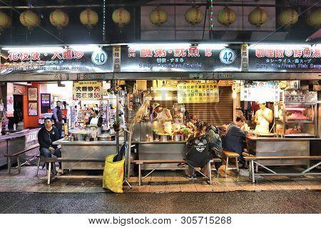 Keelung, Taiwan - November 22, 2018: People Visit Famous Miaokou Night Market In Keelung, Taiwan. Ni