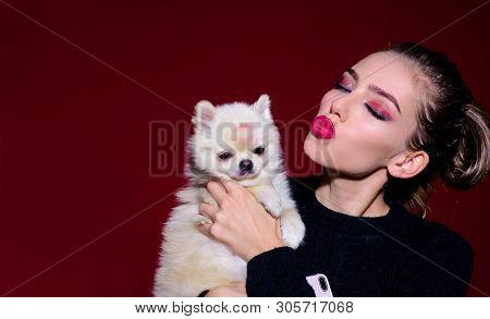 Lovely Woman Play With Dog. Girl With Eyes Closed And Puppy. Happy Woman With Pomeranian Spitz Puppy
