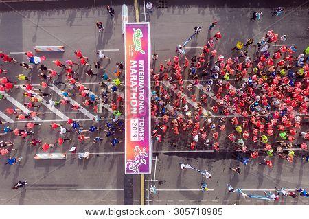 Tomsk, Russia - June 9, 2019: International Marathon Jarche Athletes Runners Crowd Are At Start. Aer