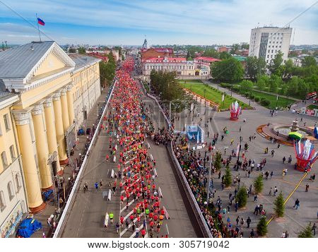 Tomsk, Russia - June 9, 2019: International Marathon Jarche Athletes Runners Crowd Are At Start. Aer