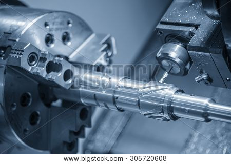 The Cnc Turn-mill Machine Cutting The Steel Shaft With Milling Spindle. The Muti-tasking Cnc Lathe M