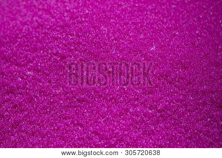 Close-up Scene The  Pile Of Pink Raw Plastic Materials. The Pellet Of The Thermoplastic Material For