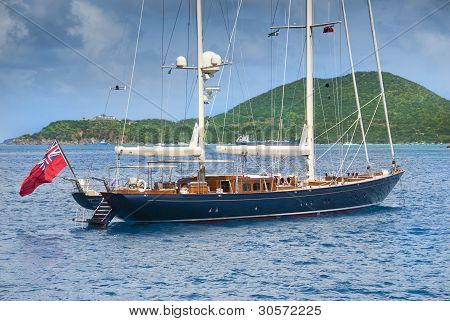 Luxury sailing yacht at anchor off Tortola, BVI poster