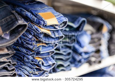 Jeans Clothes Lies Stacked In A Clothes Shop
