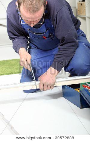 Man Using Hacksaw