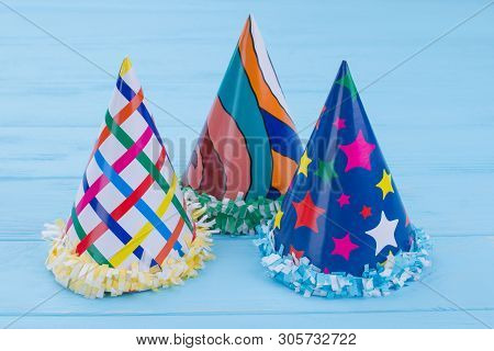 Three Patterned Party Hats On Color Background. Colorful Birthday Party Cone Caps For Celebration. D