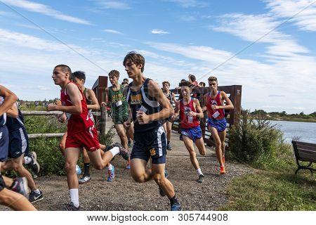 Kings Park, New York, Usa - 22 September 2018: High School Boys Cross Country Race As They Turn Righ