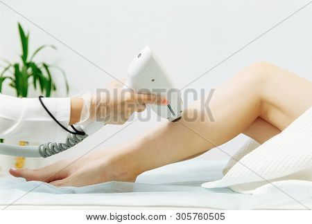 Laser Epilation And Cosmetology. Hair Removal Cosmetology Procedure.