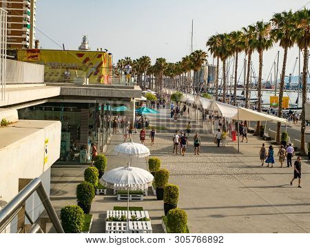 Malaga, Spain - June 23, 2018. People Are Walking Along The Embankment (paseo Del Muelle Dos Promena