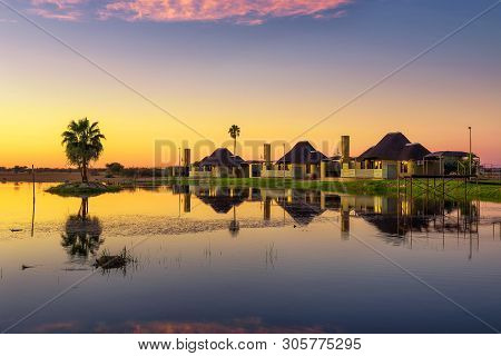 Sunrise Above A Luxury Lodge With A Lake In The Foreground Located Near Mariental In Namibia