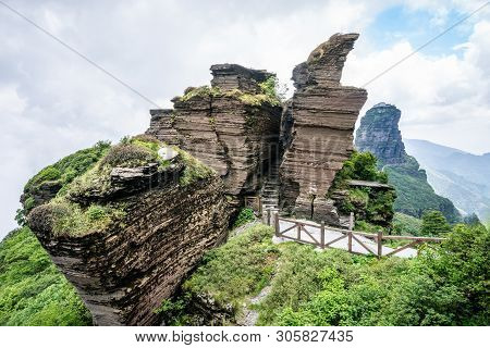 Eagle Beak Rock Formation In Fanjing Mountain With View Of The New Golden Summit In Background In Gu