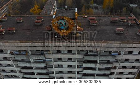 Pripyat Aerial Panorama Cityview Over The Sign Of Ussr On The Roof Of Building. Soviet Coat Of Arms