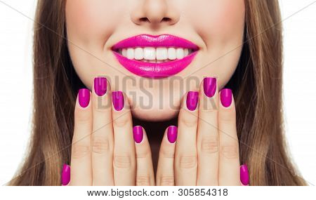 Nails And Lips. Woman Touching Her Cheeks Her Hands With Manicure Nails. Pink Color Lipstick And Nai