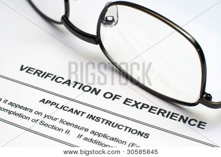 Close up of glasses on Verification Of Experience