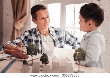 Caring Father Feeling Contended Speaking With His Son