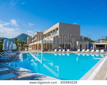 Swimming pool at the summer holydays resort hotel