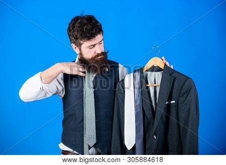 Man Bearded Hipster Hold Neckties And Formal Suit. Perfect Necktie. Shopping Concept. Stylist Advice