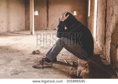 A stressed young man is worried because he is using drugs.Drug abuse concept, overdose asian male drug addict with problems. poster