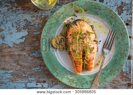 Salmon Fish Steak Grilled With Glass Of Water, Supper. Healthy Food. Top View Delicious Fried Salmon