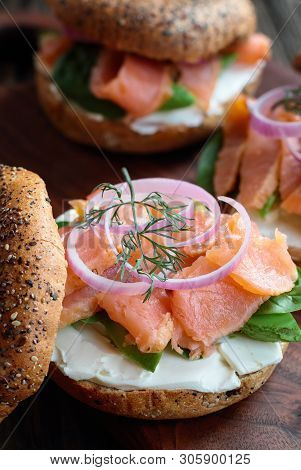 Lox - Everything Bagel With Smoked Salmon, Spinach, Red Onions, Avocado And Cream Cheese Over A Rust
