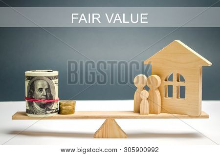 Money And Family With A House On The Scales With The Inscription Fair Value. Property Valuation. Hom