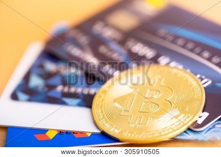 Bitcoin Golden Coin And Visa Credit Cards. Virtual Cryptocurrency Concept. Buy And Sell Bitcoin By C