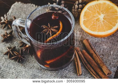 Mulled Wine. Winter Hot Beverage Made With Red Wine, Mulling Spices And Orange. Christmas Hot Alcoho