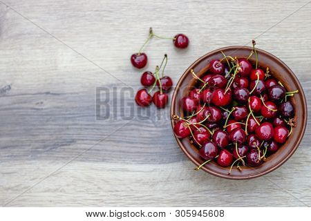 Fresh Cherry On Plate On Wooden Grey Background. Fresh Ripe Cherries. Sweet Cherries. Sweet Cherries