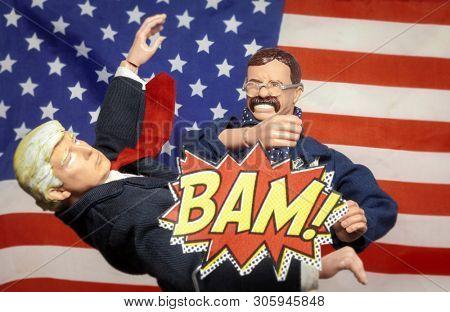 JUNE 1 2019: Theodore Teddy Roosevelt punching Donald Trump with cartoon BAM! - Republican party concept - Hasbro GI Joe series action figure / Stevenson Entertainment Group Figure