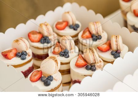 Various Mini Cakes. Sweets Decorated With Fresh Berries For Holiday.tasty Cake.small Cakes With Vari