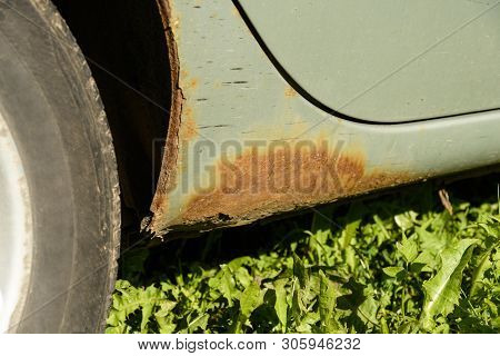 Rusted Bottom And The Fender Of The Car, Lagging Paint, Swollen Paint