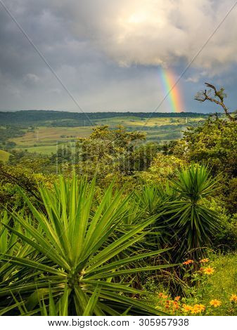 Rainstorm and rainbow over Rincón de la Vieja National Park in Costa Rica