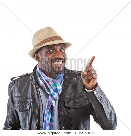 Young stylish black man pointing with his finger.