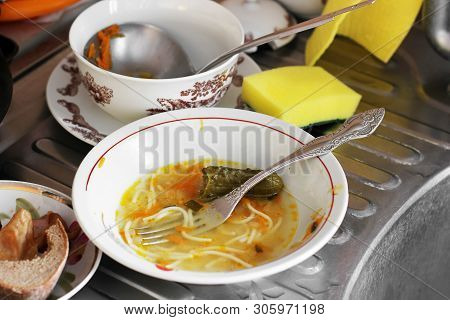 Dirty Dishes In The Kitchen. Unwashed Dishes