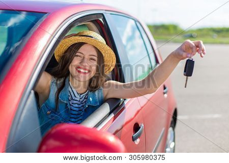 Driver Woman Smiling Showing New Car Keys And Car. Happy Woman Driver Showing Car Keys And Leaning O