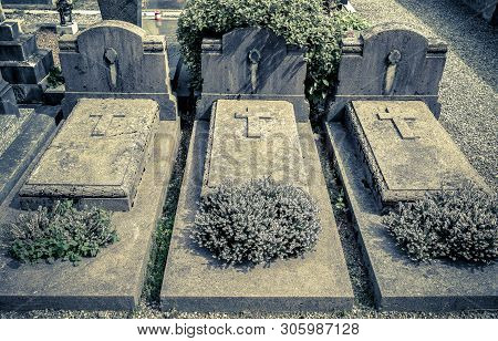 The Headstones and Graves of catholic Cemetery. poster