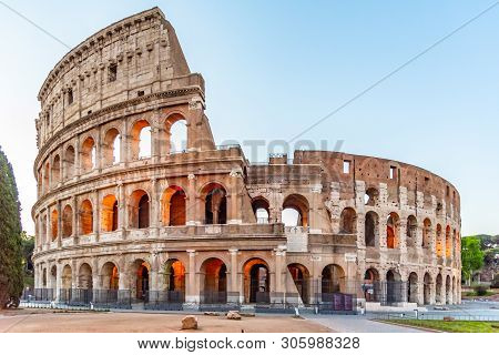 Colosseum, Or Coliseum. Illuminated Huge Roman Amphitheatre Early In The Morning, Rome, Italy