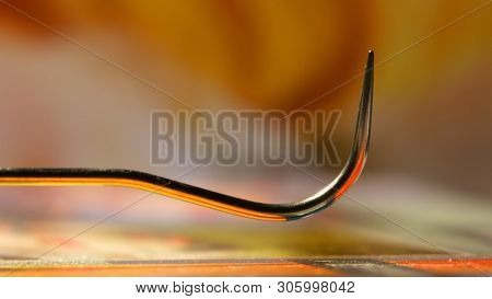 Sharp curved  dental tool close up shot