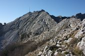 one side of the peaks of the mountains of the Tuscan Apuan Alps in Montignoso. Rocky Apennines on a summer day poster