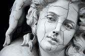 Cracked face of ancient female Greek sculpture poster