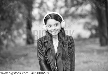 Cute And Adorable. Cute Girl Listen To Music In Park. Cute Look Of Music Lover. Fashion Accessory. T