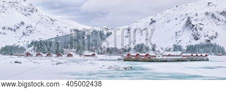 Astonishing Winter Scenery With Traditional Norwegian Red Wooden Houses On The Shore Of Rolvsfjord O
