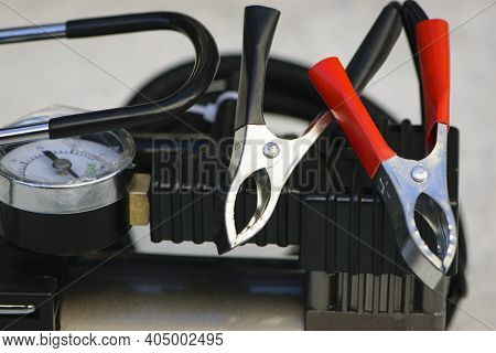 Pump Compressor For Inflating Car Wheels Close-up. Car Pump In A Black Case On A White Background. P
